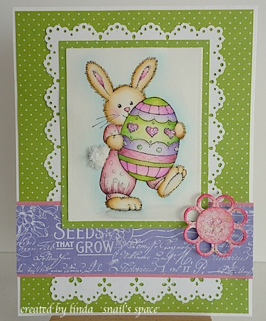 card with easter bunny holding a big egg in purple, pink and green