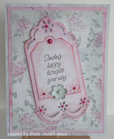 card with tag, pearls and a flower in pink and green