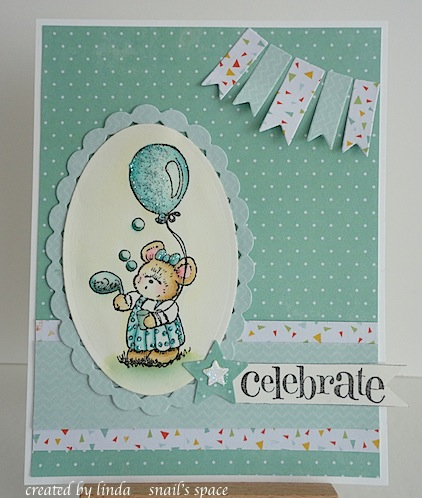 mouse blowing bubbles with a balloon and a celebrate sentiment in aqua with glitter on her dress