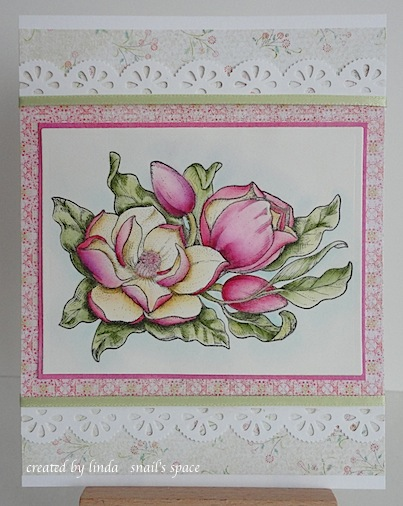 card with pink magnolias, green leaves and pink and green paper with two lacy punched borders