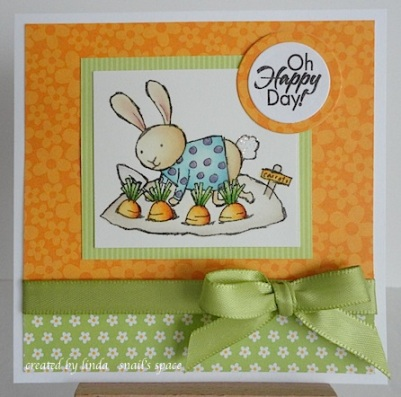 card with bunny planting carrots and sentiment with oh happy day!