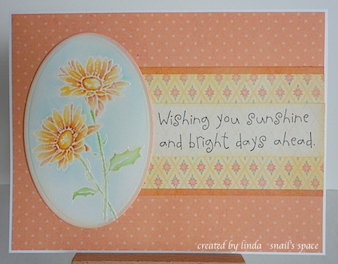 orange card with two yellow and orange daisies