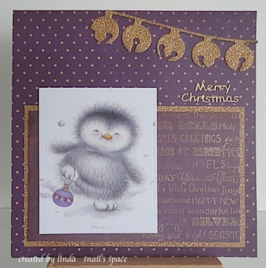another christmas card in purple and gold with a penguin and jingle bells