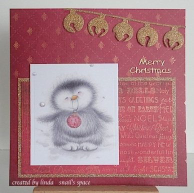 christmas card in burgundy and gold with a penguin and jingle bells