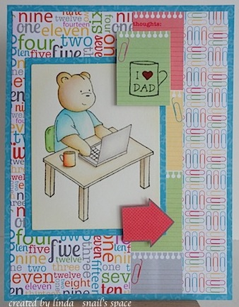 card with teddy bear sitting at computer desk with mug and stationery print background paper along with a mug and sentiment that says i heart dad