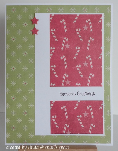christmas card in red and green with candy canes, stars and season's greetings sentiment