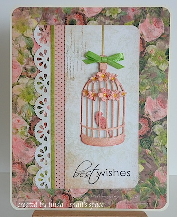 card in bronze and green with diecut birdcage, bird and flowers with best wishes sentiment