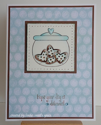 card in blue and chocolate brown with jar of heart shaped cookies and hope your day is delicious sentiment