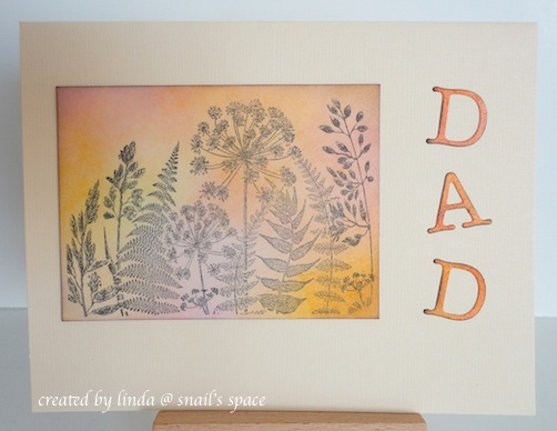 father's day card with stamped black wildflowers surrounded by orange, pink and red sponged ink