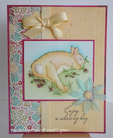 card with resting bunny in grass and clover with blue, green and burgundy papers and a sentiment of enjoy a relaxing day