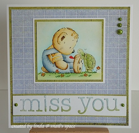 card with teddy in blue coveralls sitting on the ground with a turtle and a miss you sentiment