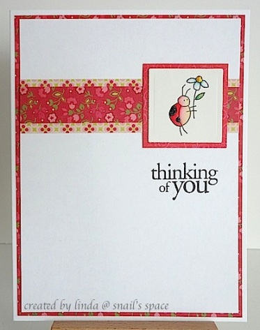 copyright by linda @ snail's space and described here for people with disabilities; a thinking of you card in red and white with a ladybug holding a white daisy
