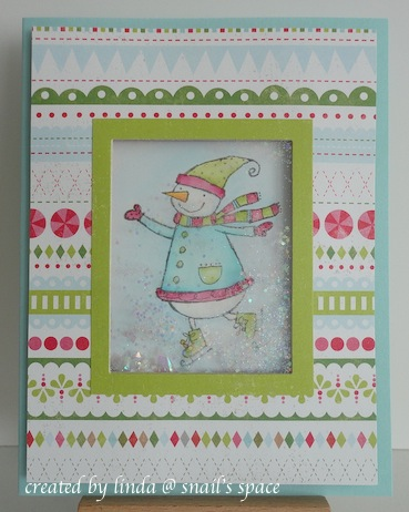 copyright by linda @ snail's space and described here for people with disabilities; christmas card in neon green, pink and blue with snowgirl behind a shaker section