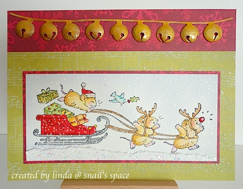 copyright linda @ snail's space and described here for people with disabilities; christmas card with red sleigh, driven by a mouse and two other mice with reindeer antlers on a green background with gold jingle bells at the top on a red background