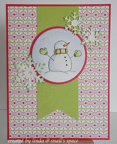 copyright linda @ snailzpace.wordpress.com and described here for people with disabilities; a christmas card featuring a snowman wearing red and green mittens and scarf with three glittered snowflakes and print paper
