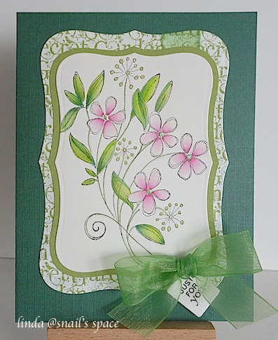 copyright linda @ snail's space and described here solely for people with disabilities; a card with pink wildflowers, green leaves, green text border on a green card base with a sheer green ribbon and a just for you sentiment stamped on a tiny tag