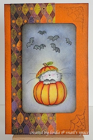 COPYRIGHT LINDA @ SNAIL'S SPACE AND DESCRIBED SOLELY FOR PEOPLE WITH DISABILITIES; a halloween card with a cat in a pumpkin, dark night sky and six bats flying overhead