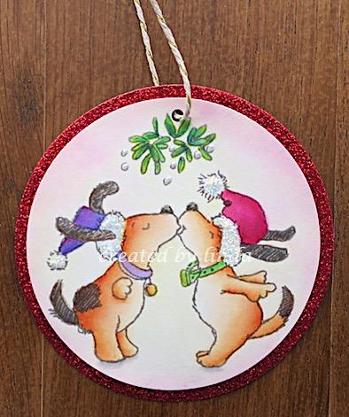 dog couple under mistletoe tag