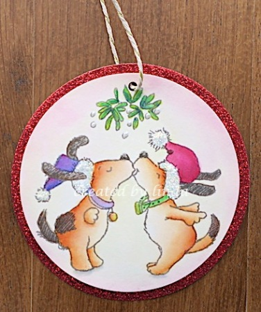 dog couple under mistletoe tag