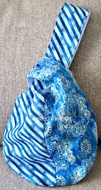 blue fabric knot bag