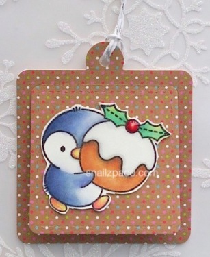 holiday tag featuring clearly besotted penguin with figgy pudding copyright Linda snailzpace.com