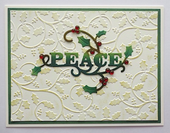 Christmas cards featuring peace die cut sentiment with embossed holly background copyright Linda snailzpace.com